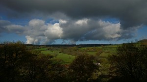 cloudy skies over green pastures